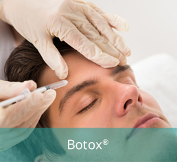 Doctor injecting botox to forehead